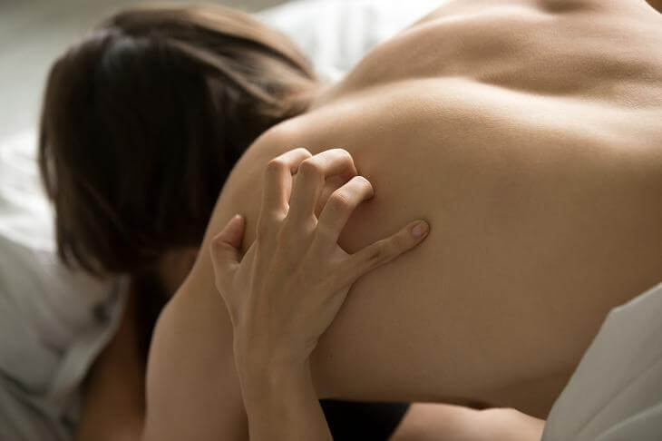 female-hand-scratching-lovers-back-having-passionate-sex-close-up
